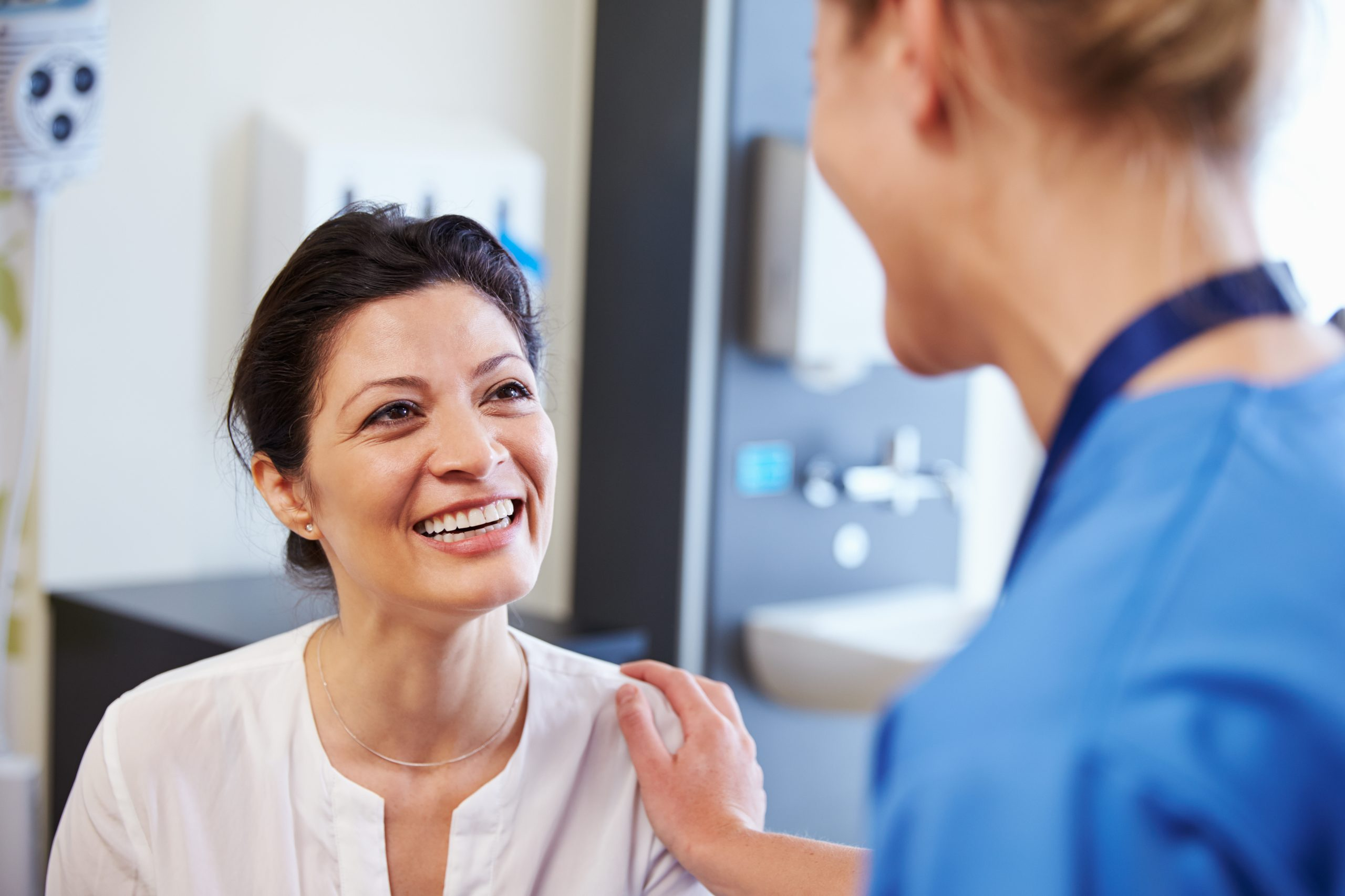 Female Patient Being Reassured By Doctor during immigration physicals